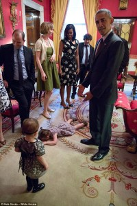 Kicking up a fuss: Claudia Chaudhary is pictured above having a tantrum in front of President Obama in the White House's Red Room during a reception before this year's annual Passover Seder