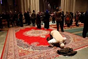 Muslims pray inside the Washington National Cathedral