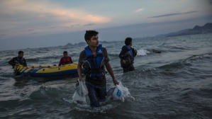 Pakistani migrants arrive on the beach in Kos, Greece, at dawn after making their way from Turkey Photo: Dan Kitwood