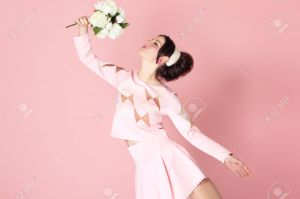 Woman With Flowers In Pink