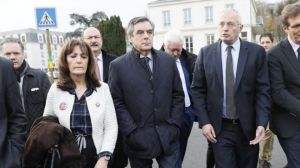 Mr Fillon (C) has become the unexpected frontrunner in France's Republican race for the presidential nomination